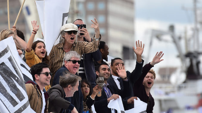 A boat carrying supporters for the Remain in the EU campaign including Bob Geldof (C) shout and wave at Brexit fishing boats as they sail up the river Thames in central London on June 15, 2016. A Brexit flotilla of fishing boats sailed up the River Thames into London today with foghorns sounding, in a protest against EU fishing quotas by the campaign for Britain to leave the European Union. / AFP / BEN STANSALL        (Photo credit should read BEN STANSALL/AFP/Getty Images)
